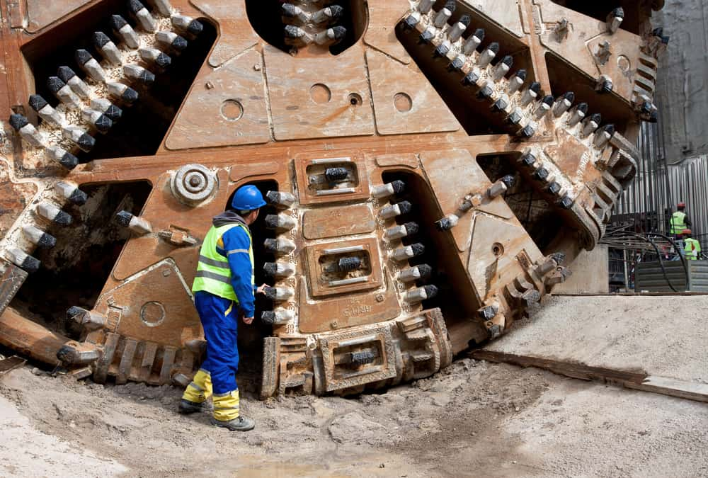 Laser guided tunnelling machines bore the Channel Tunnel