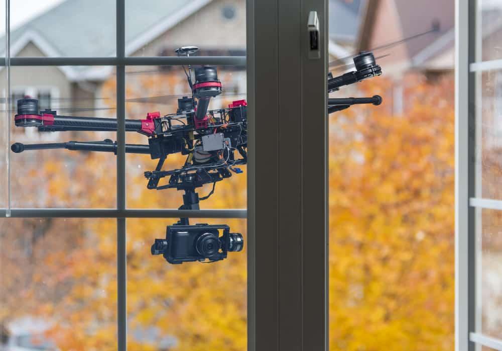 UAV flies past window demonstrating R&D in drones