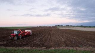 Agriculture. Tractor planting potato crop. R&D. Agri-tech. Farming.