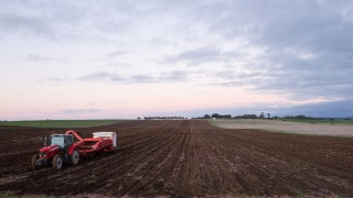 Tractor planting potato crop R&D in Agri-tech