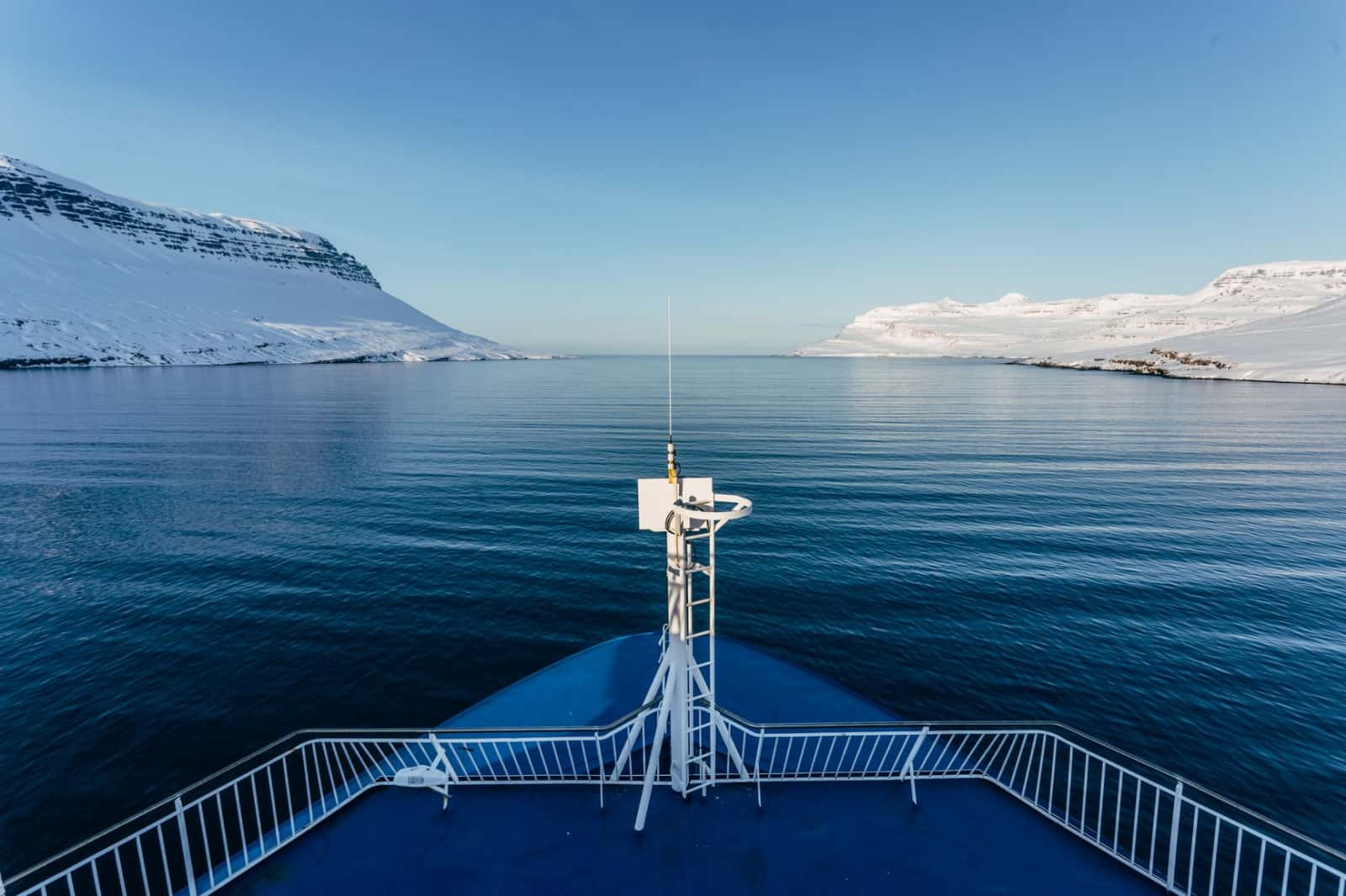 Research ROV vessel sailing through arctic fjord in Iceland