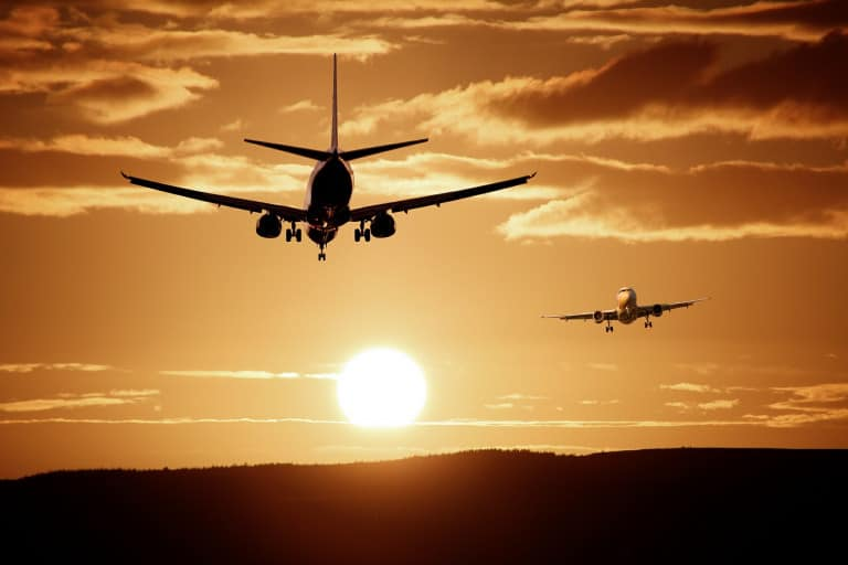 Airplane at airport - compare flight prices with big data - traveltech