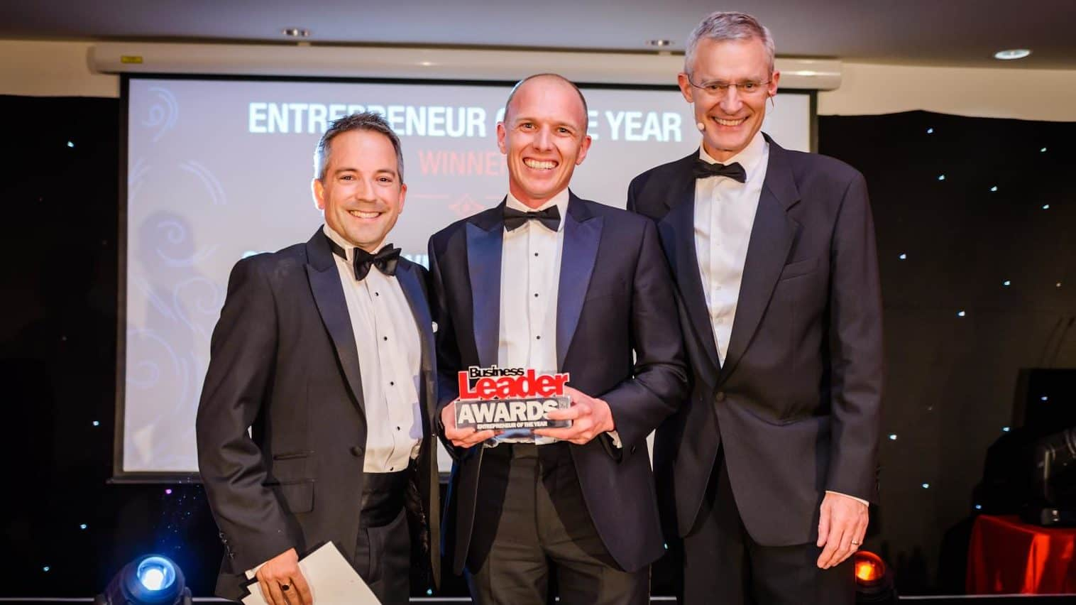 Simon Brown (centre) awarded entrepreneur of the year